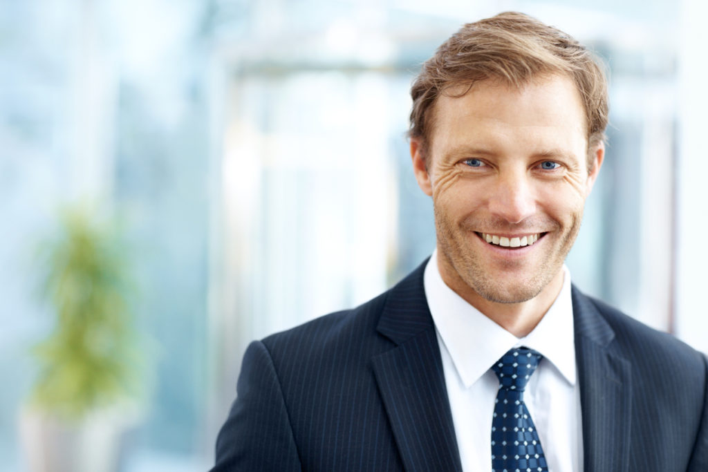 Smiling senior male executive at Boss Finance
