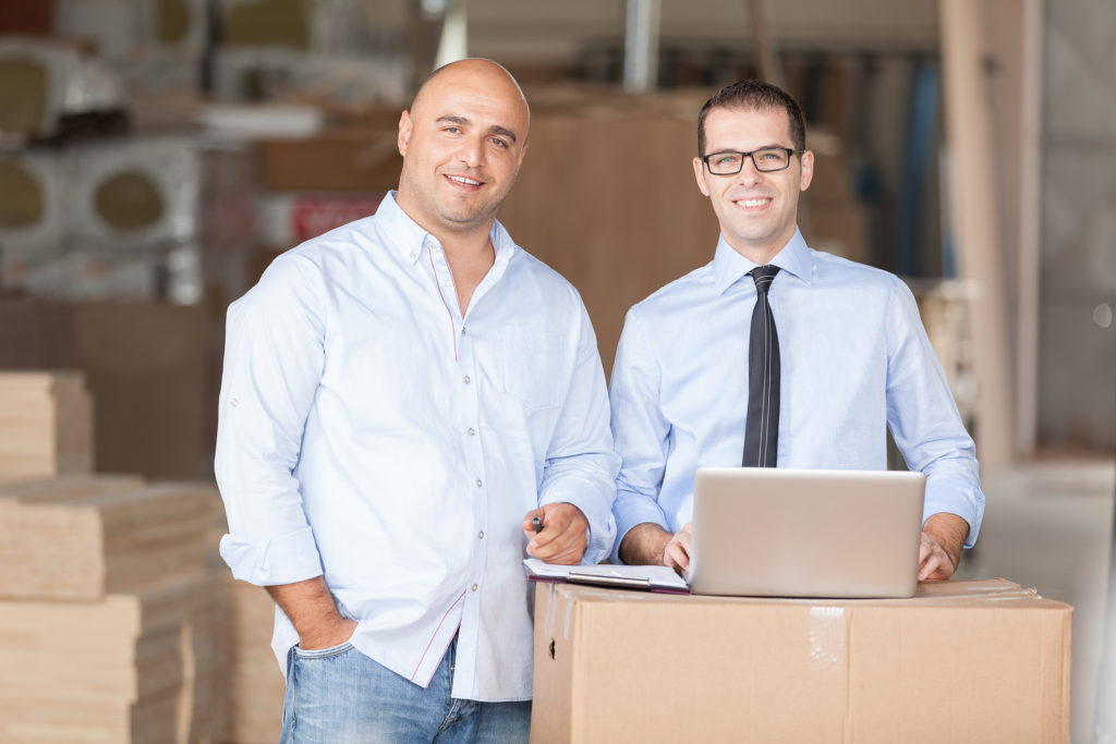 Accountant with his client at warehouse